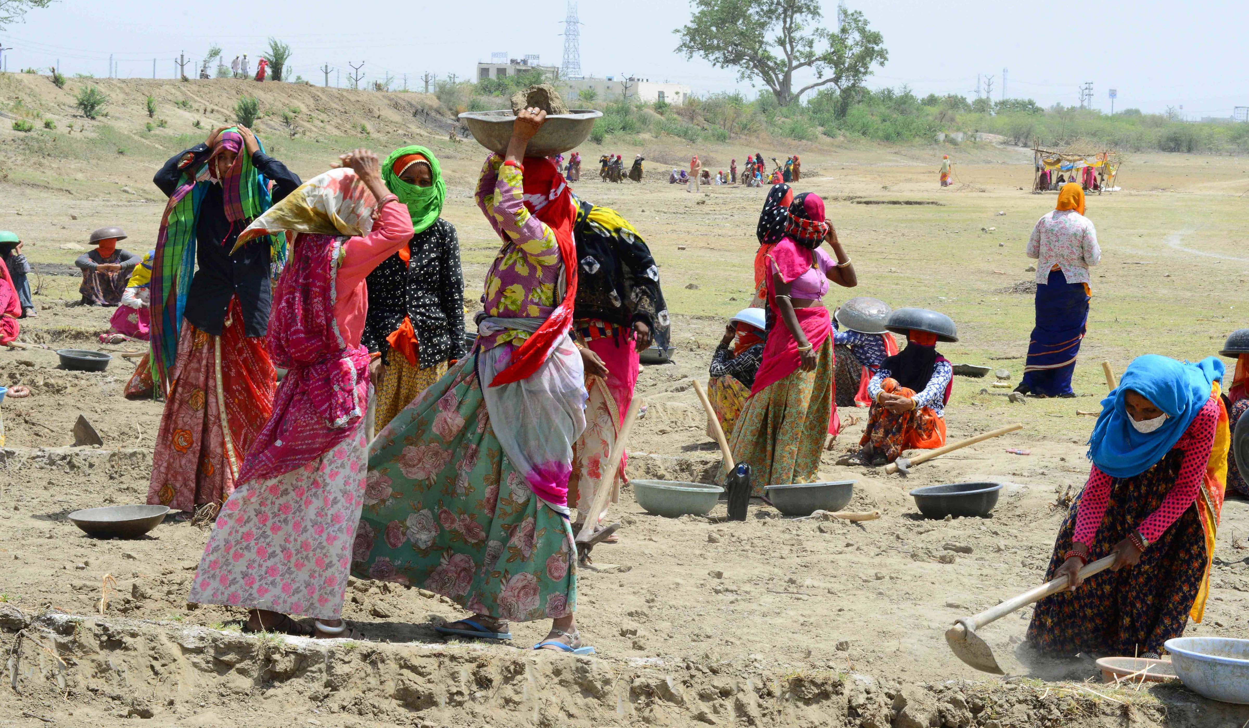 Labourers under MNREGA work at a site in Beawar on Friday.