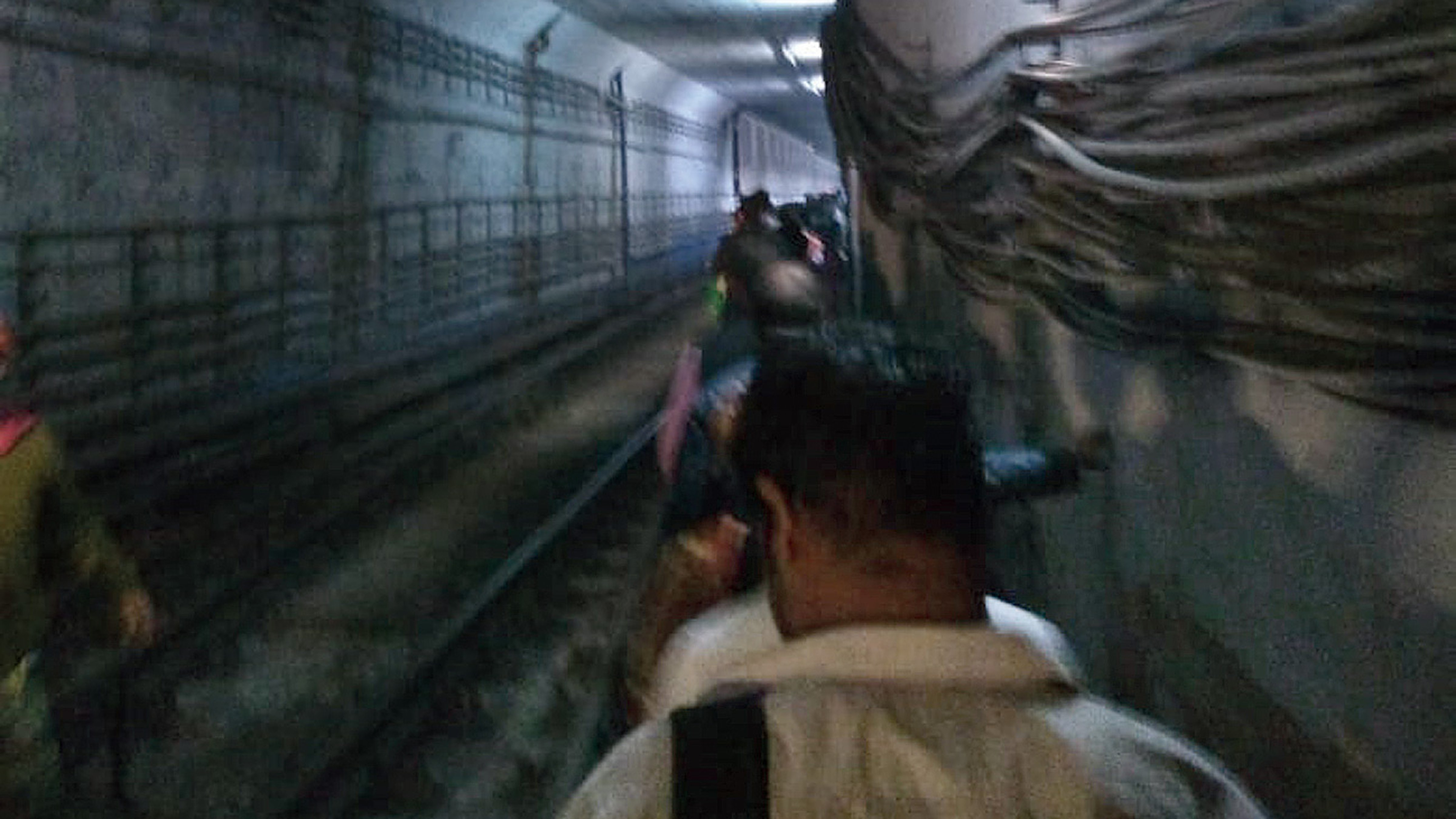Passengers being evacuated through the tunnel leading to Maidan Metro station after the train fire on Thursday.