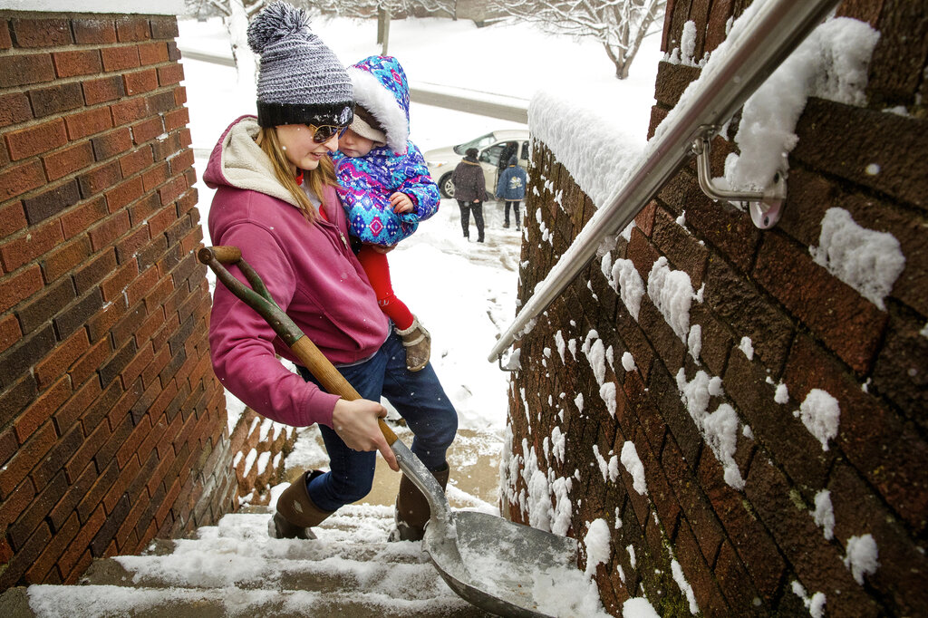 While some families were having fun, some were hard at work, trying clear their homes of snow.
