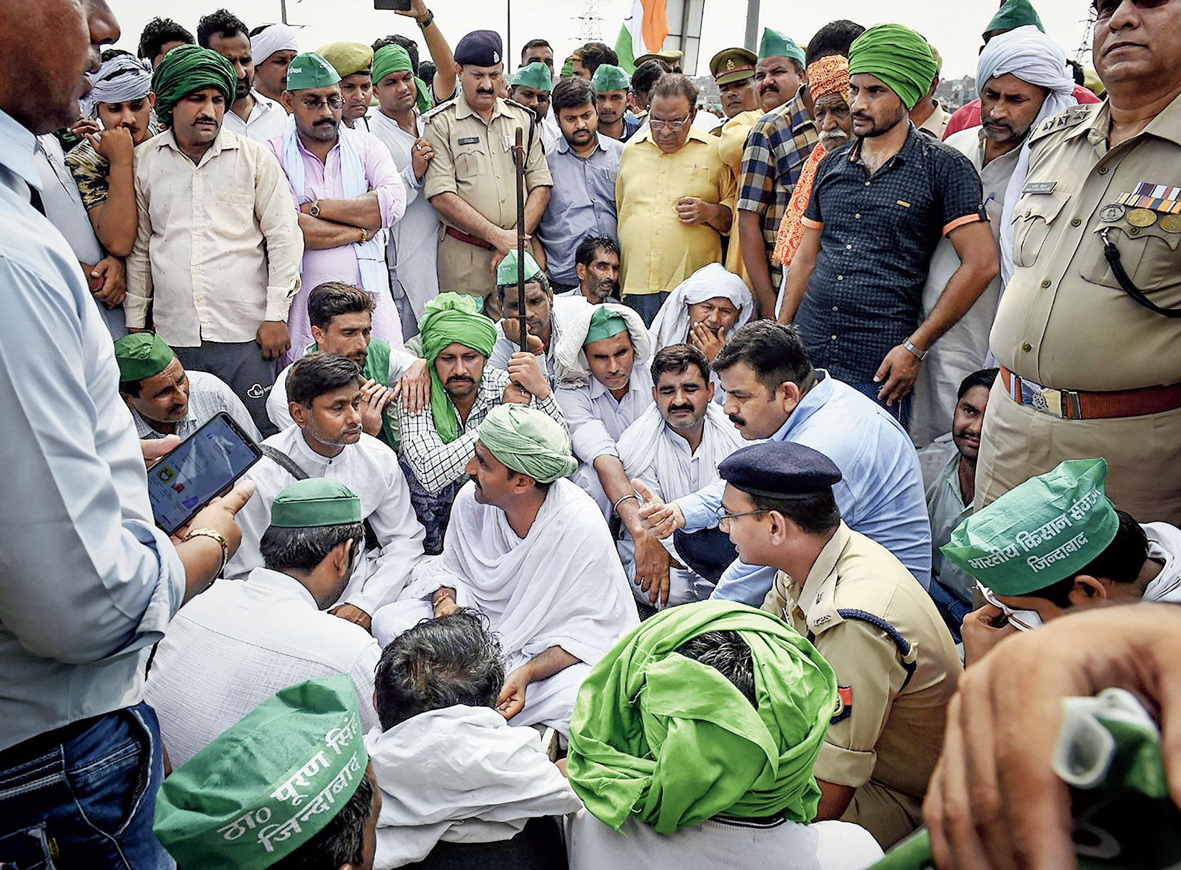 Farmers block NH24 during their agitation at the Ghazipur border on Saturday.