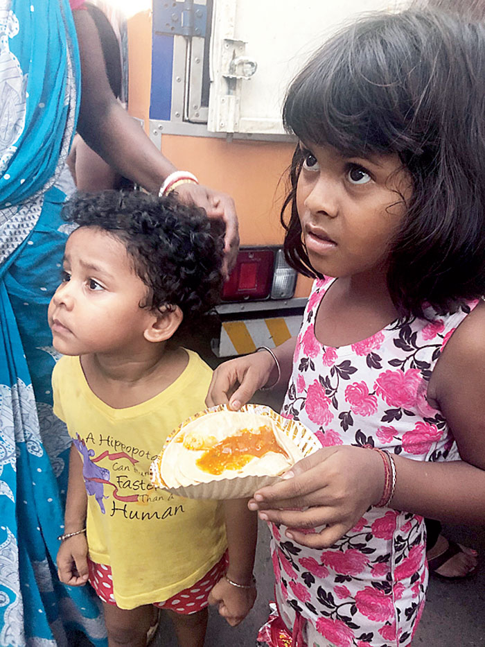 Once his or her turn at the queue comes, the hungry little girl or boy takes the hot plate and dashes home. Some stand and stare at the food before gulping it all down