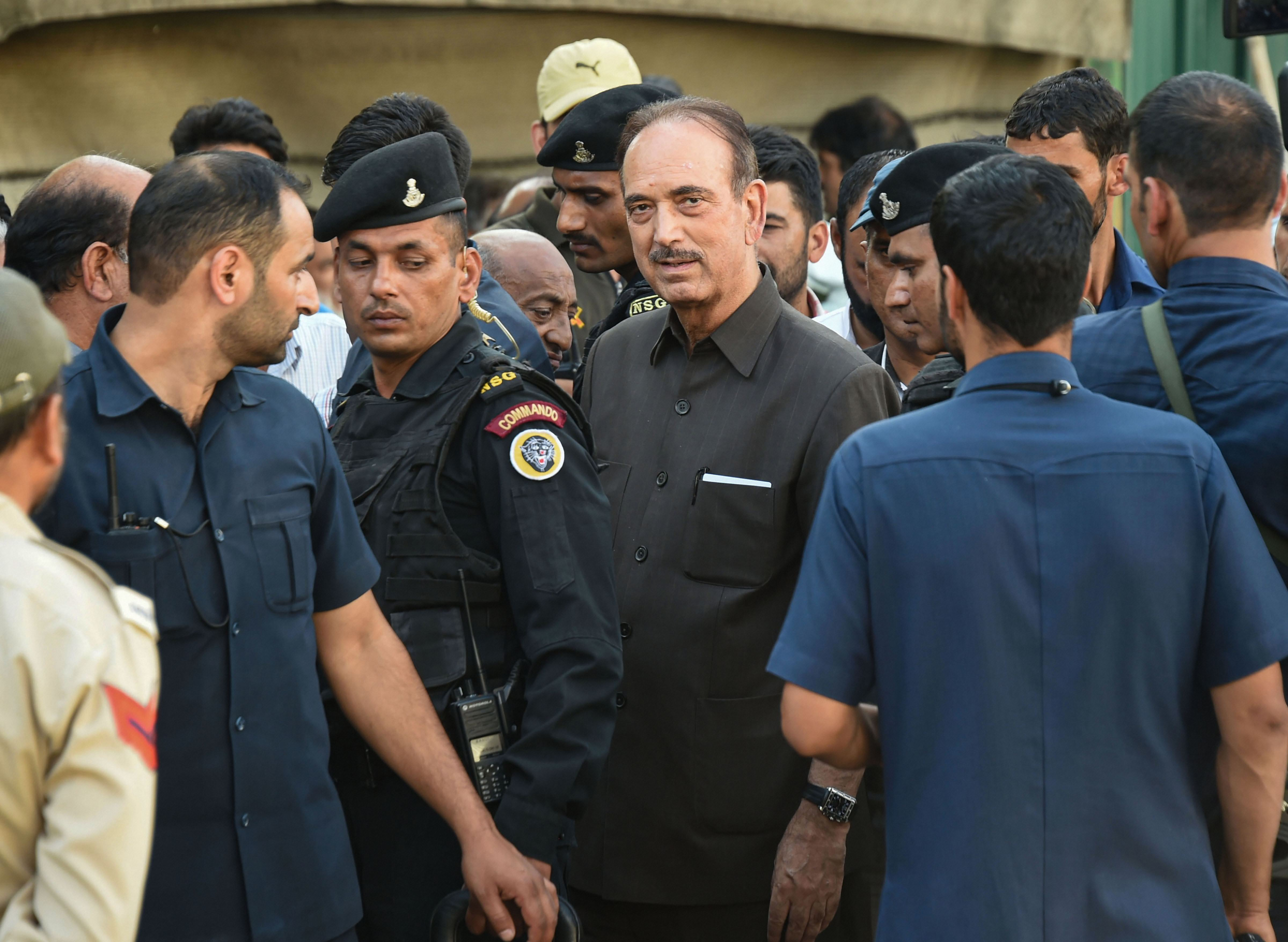 In this September 21, 2019, file photo, Congress leader Ghulam Nabi Azad talks with transporters and house boat owners at the tourist reception centre, in Srinagar. Azad hailed the Supreme Court's order in which it asked  the J&K administration to review within a week all orders imposing curbs.
