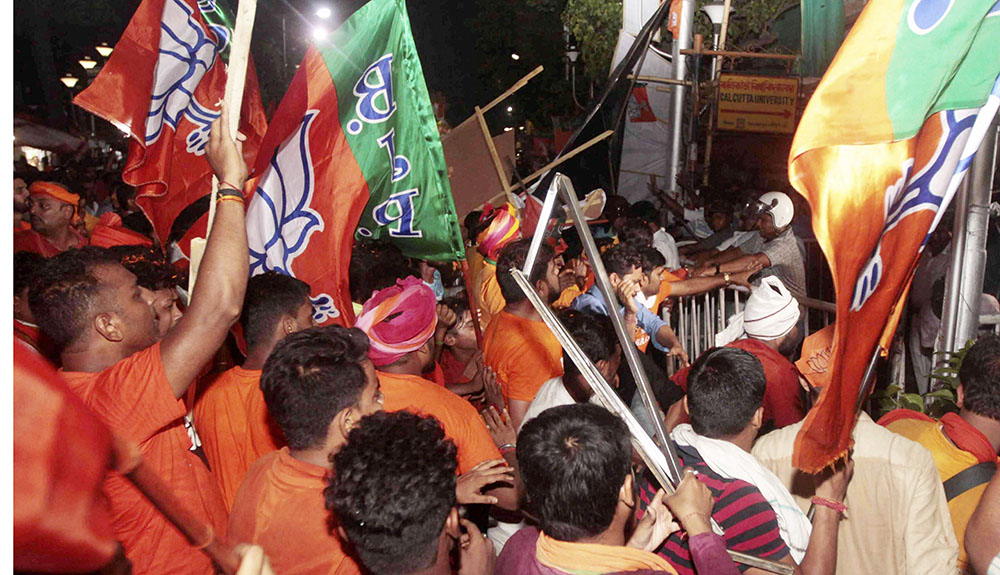 BJP supporters clash with police personnel during BJP President Amit Shah's election roadshow for the last phase of Lok Sabha polls, in Calcutta, Tuesday, May 14, 2019.