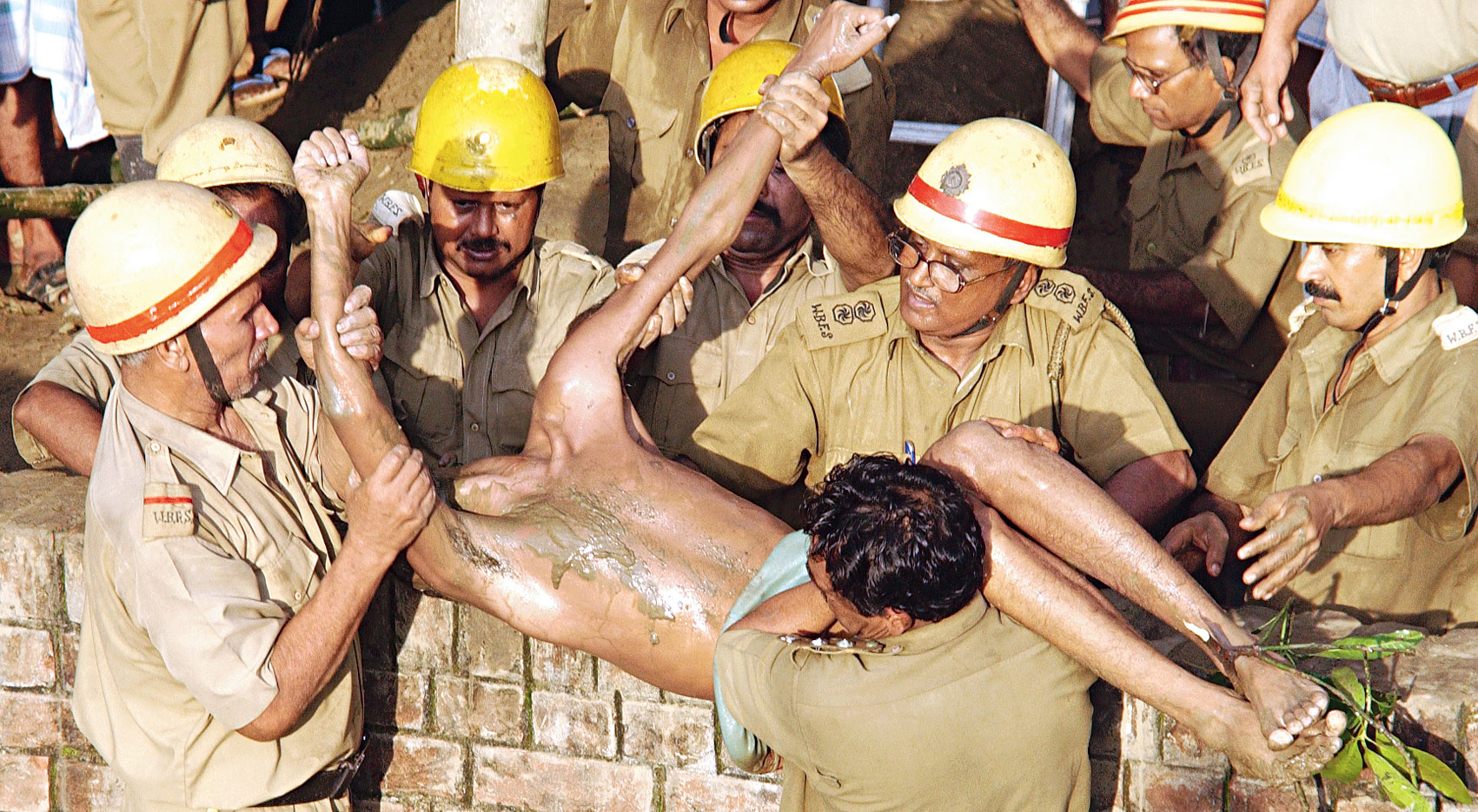A manual scavenger's body being taken out of a septic tank in Howrah district.