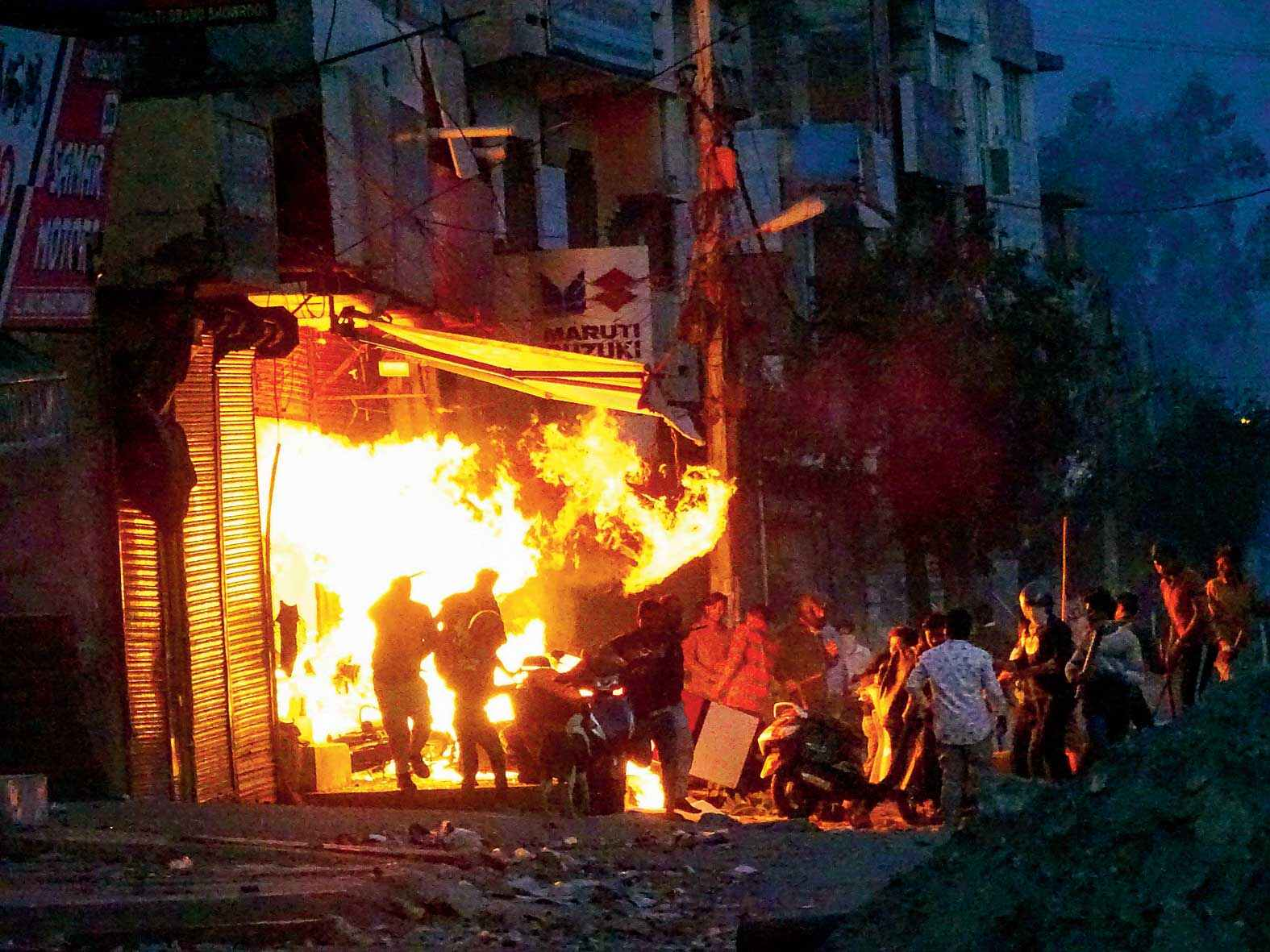 Rioters set ablaze a shop in northeast Delhi. Chhatra RJD unit of JNU had demanded the release of Meeran Haider and said the police should become ''people-friendly'' and not scare people.