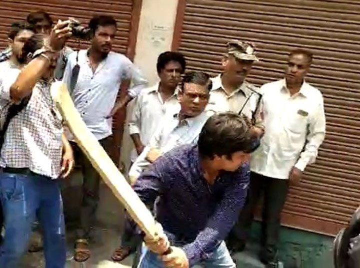 Akash went about beating up the officer even as mediapersons surrounded him with cameras and recorded the entire incident.