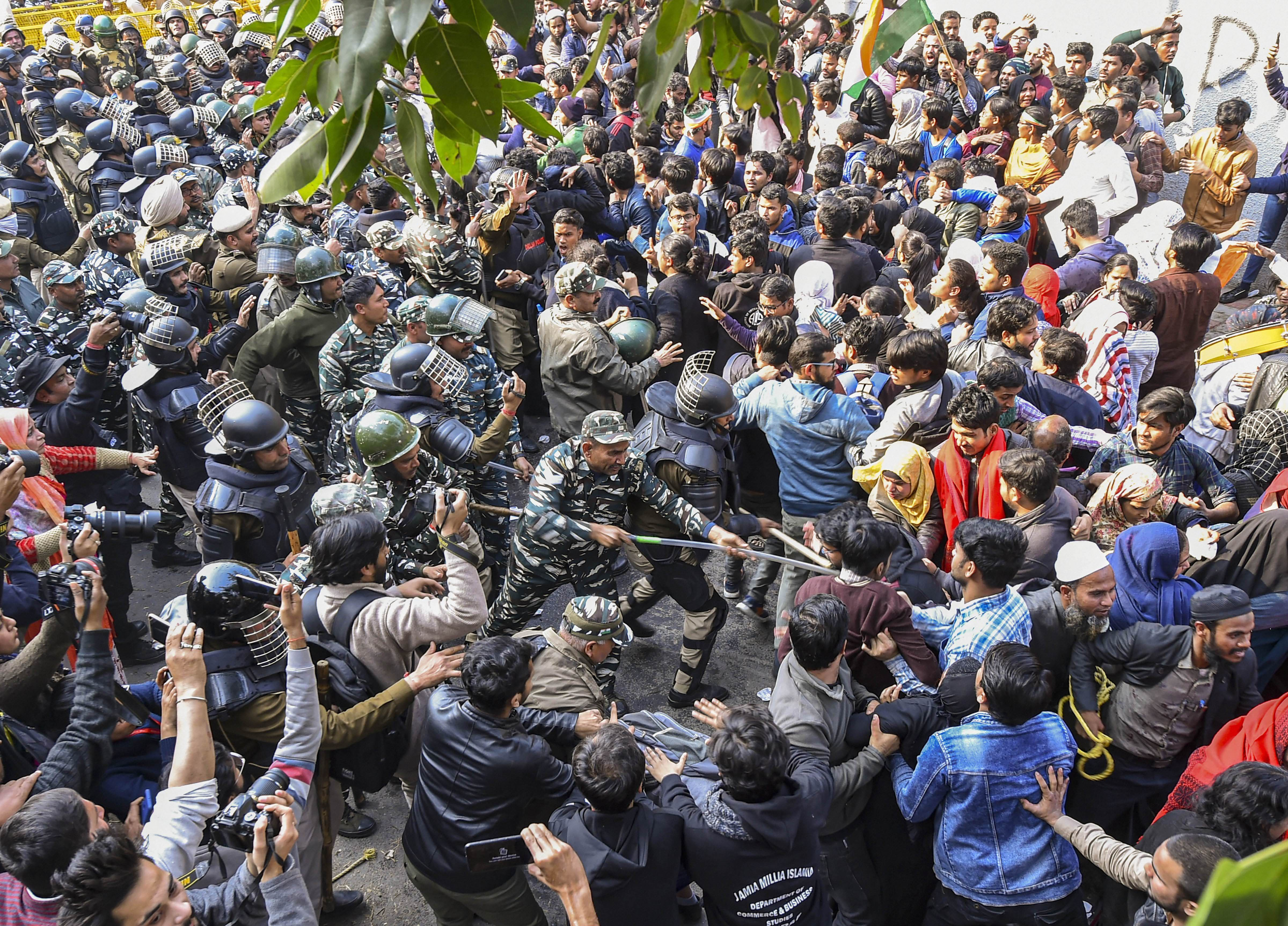 Police baton charge protesters to push them back during their march against the amended Citizenship Act, NRC and NPR, near Jamia Nagar in New Delhi, Monday, Feb. 10, 2020.