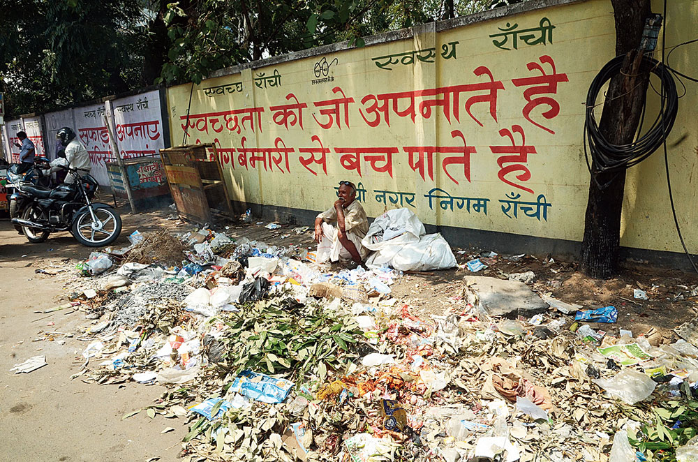 Garbage strewn in front of a wall with a cleanliness slogan written on it on Main Road in Ranchi on Wednesday