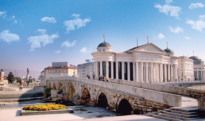 Skopje's Archeological Museum stands next to an ancient stone bridge over the Vardar River