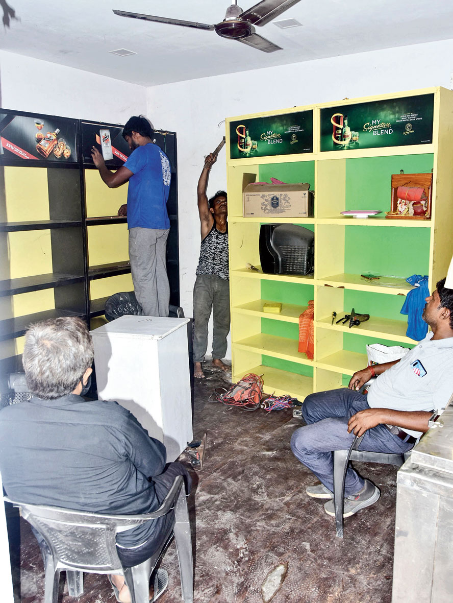 A liquor shop gets renovated on Police Lines Road in Dhanbad on Tuesday.