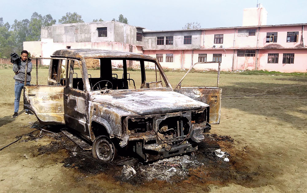 The police vehicle in which inspector Subodh Kumar Singh was seated when the crowd attacked it with stones, forcing him to flee. The crowd later set the vehicle on fire at Syana in Bulandshahr on December 3.
