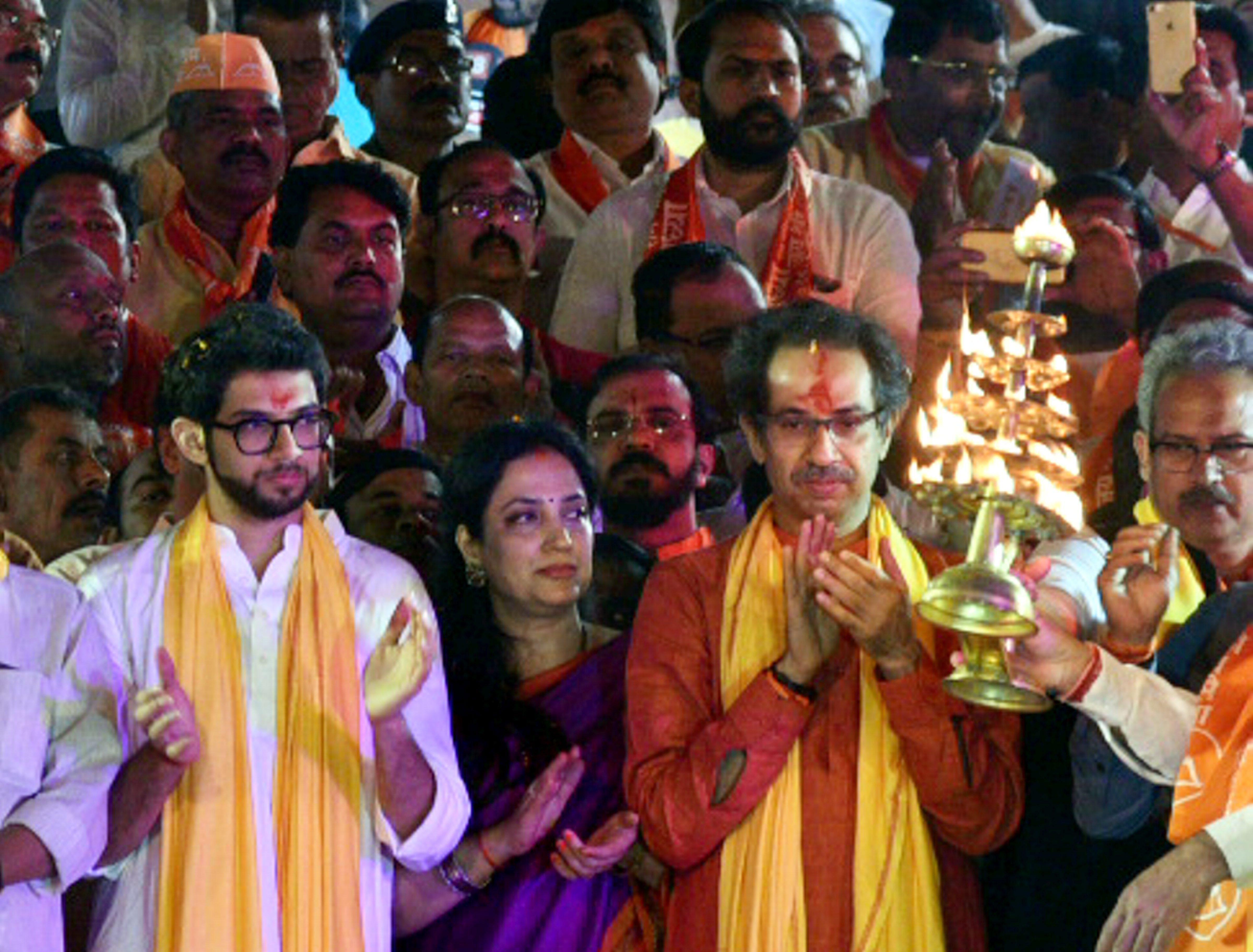 Shiv Sena chief Uddhav Thackeray, Yuva Sena chief Aditya Thackeray and Rashmi Thackeray offer prayers during Saryu aarti at a ghat in Ayodhya on Saturday