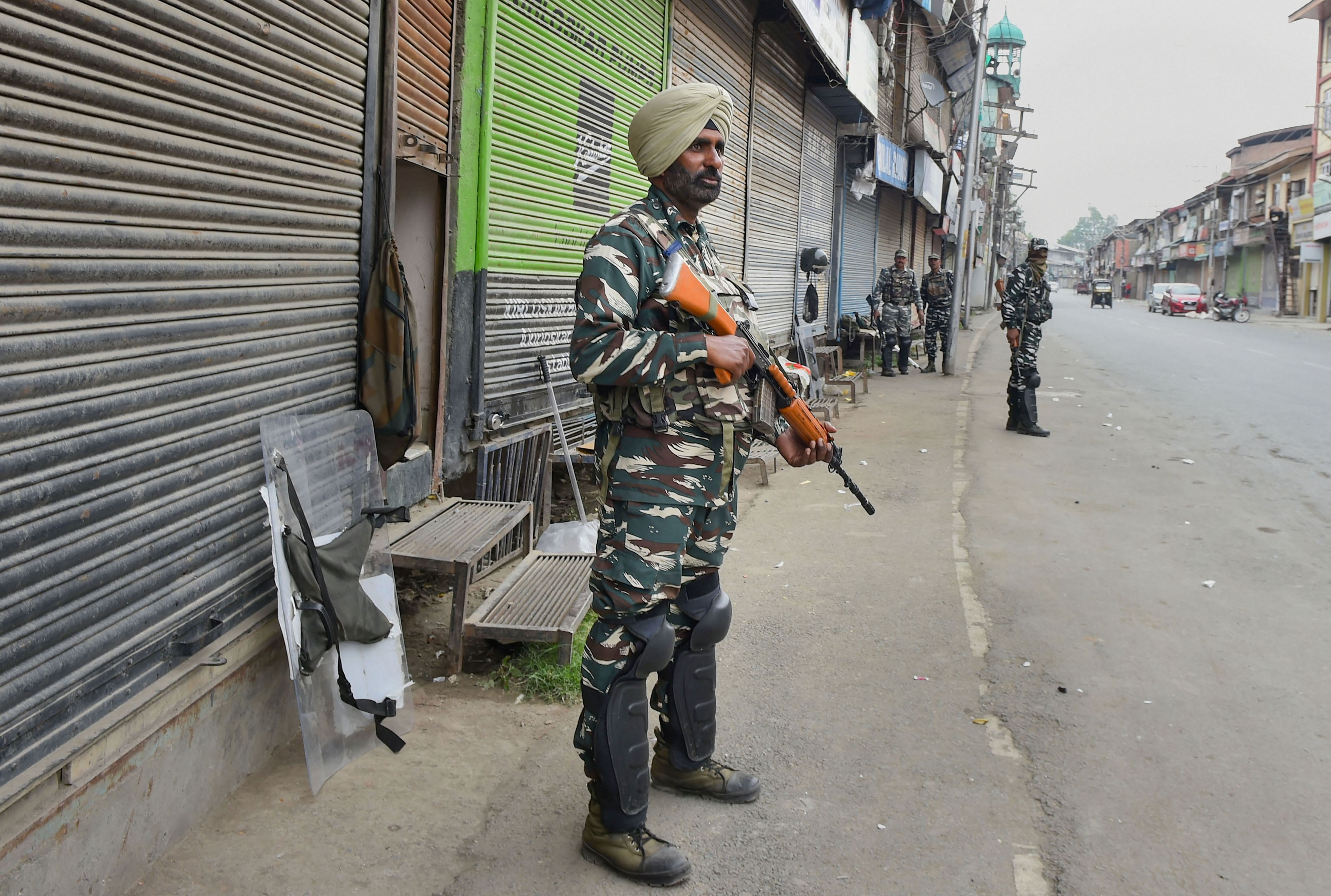 Security personnel out in Srinagar on October 3.