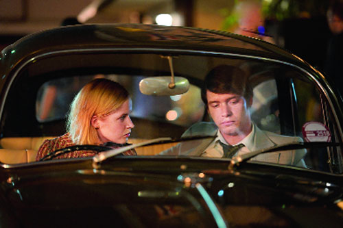 Billy Howle as Herman Knippenberg with Ellie Bamber playing his wife