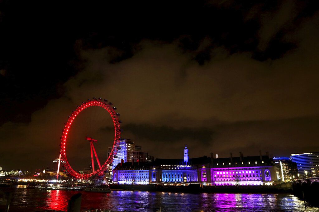 London Eye and other buildings on the south bank of the River Thames, illuminated in central London, England