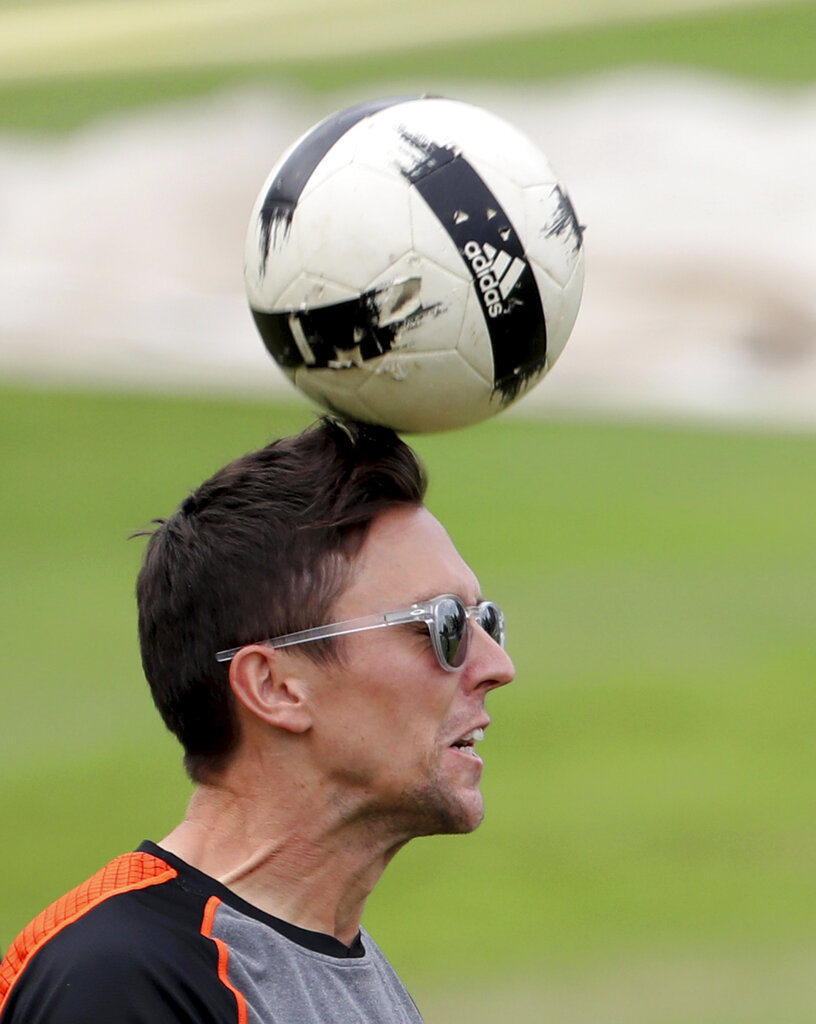 New Zealand's Trent Boult heads a soccer ball during a training session ahead of the Cricket World Cup final match against England at Lord's cricket ground in London, England, Saturday, July 13, 2019.