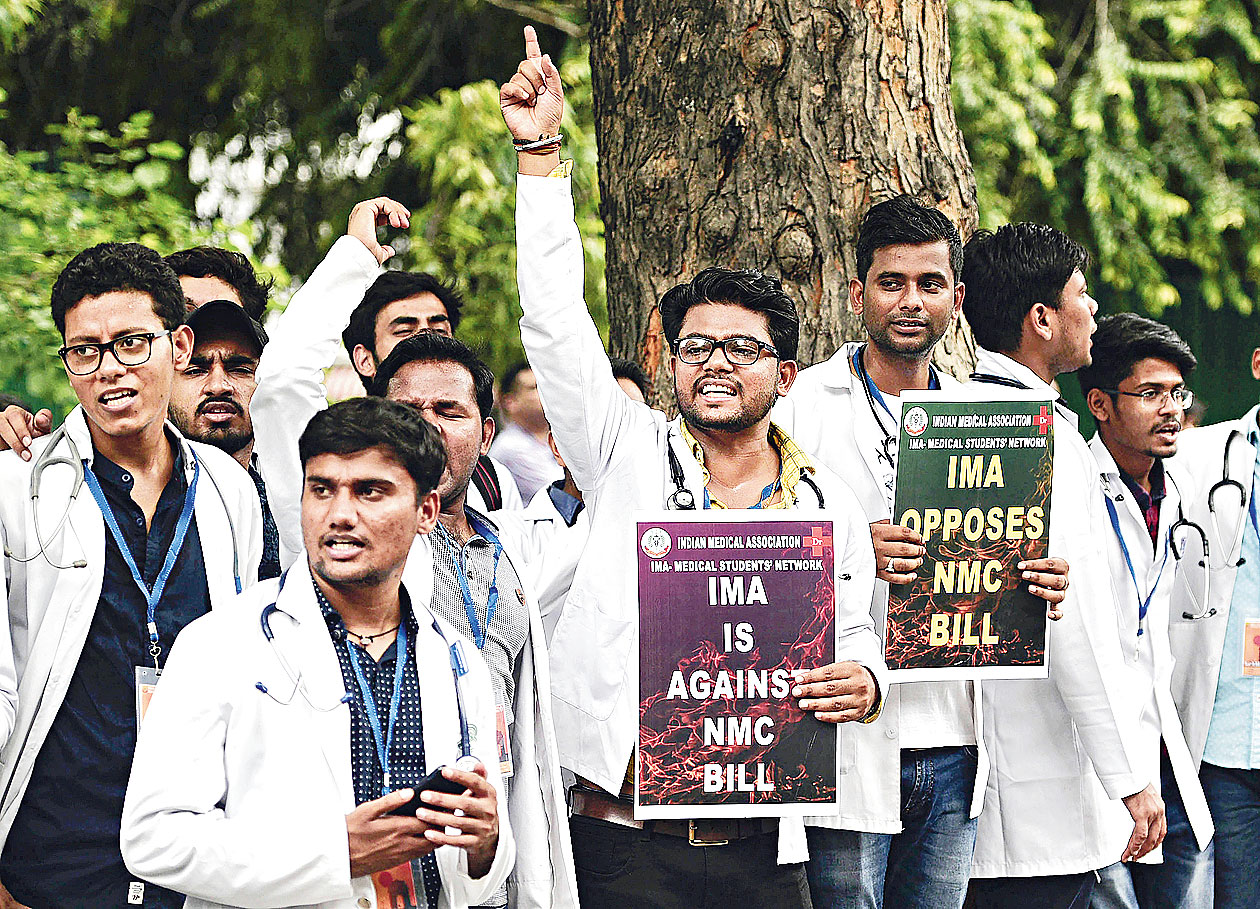 Doctors and students from IMA protest against the National Medical Commission Bill in New Delhi on Monday.