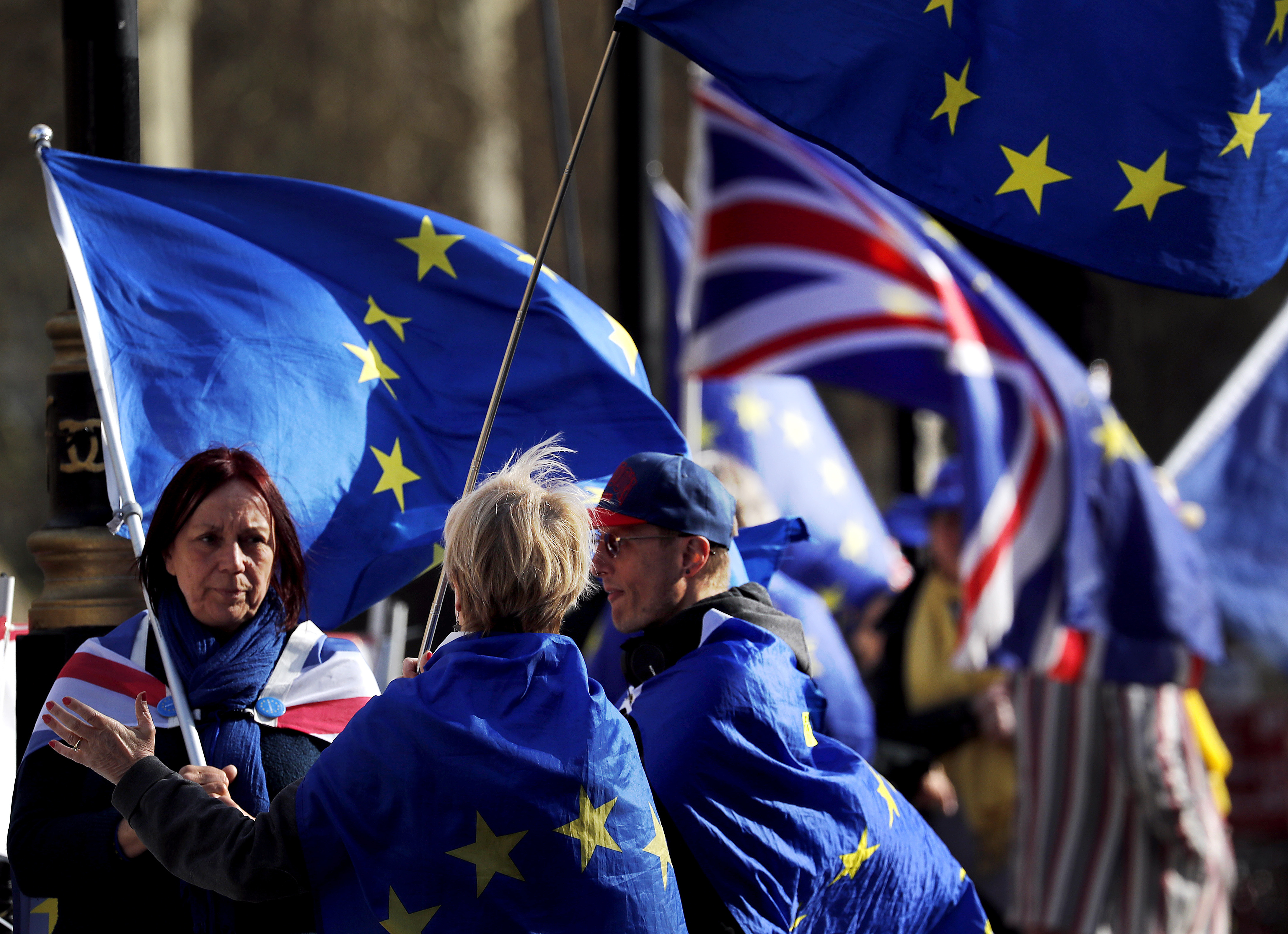 Brexit protesters demonstrate near the House of Parliament in London, Tuesday, March 26, 2019