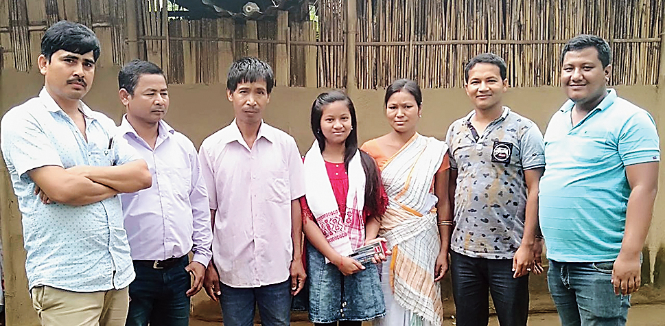 Pranali Neog with her parents, teachers and well-wishers.