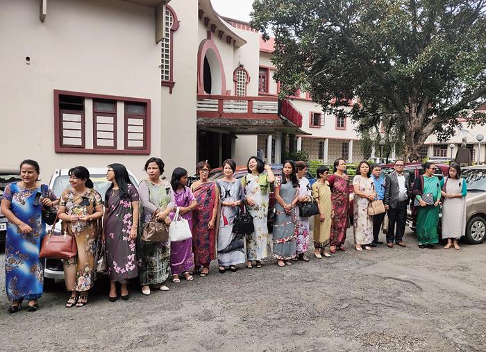 Teachers protest outside U Soso Tham auditorium on Thursday