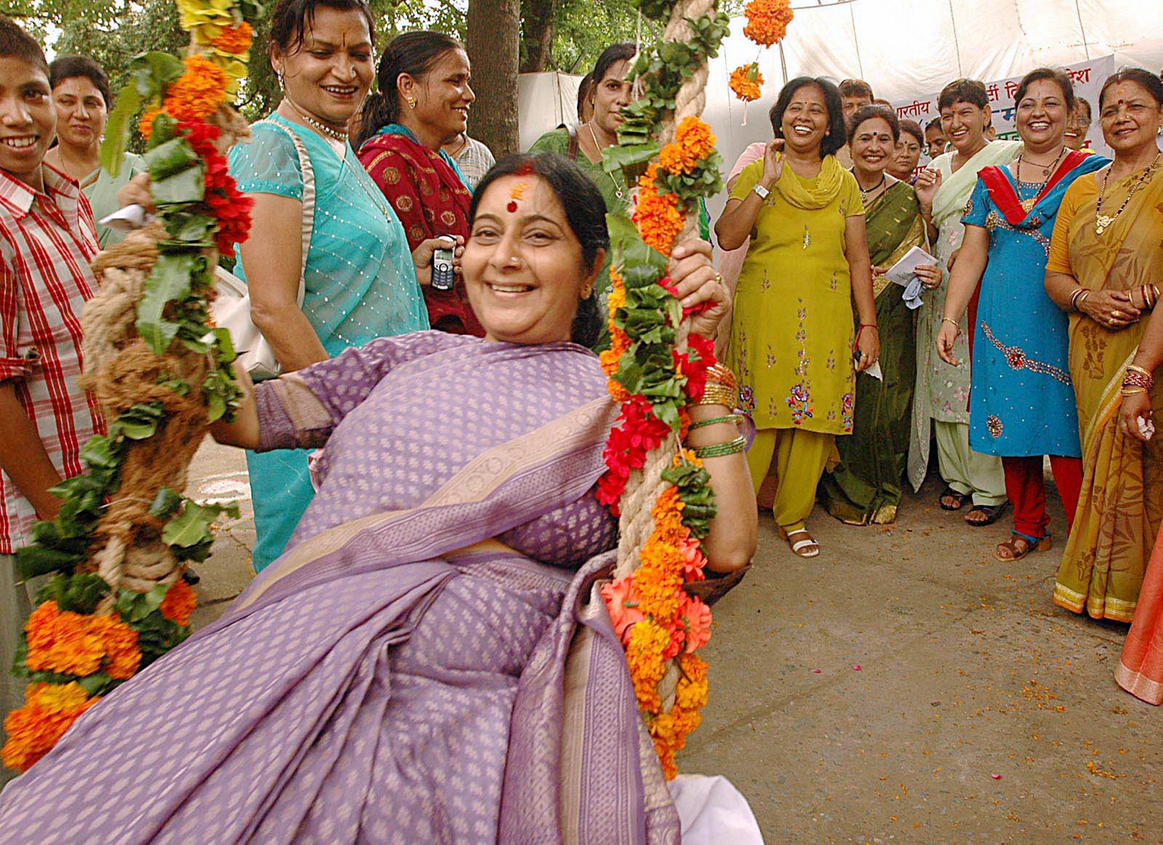 An August 5, 2005, photo, in which BJP MP Sushma Swaraj is on a swing during Teej in New Delhi.
