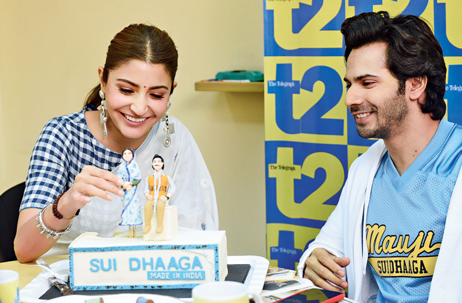 "tall tales: ""Let me make her taller than you,"" laughed Anushka, picking up 'Mamta' on the cake. ""I am still on a pedestal!"" laughed Varun."