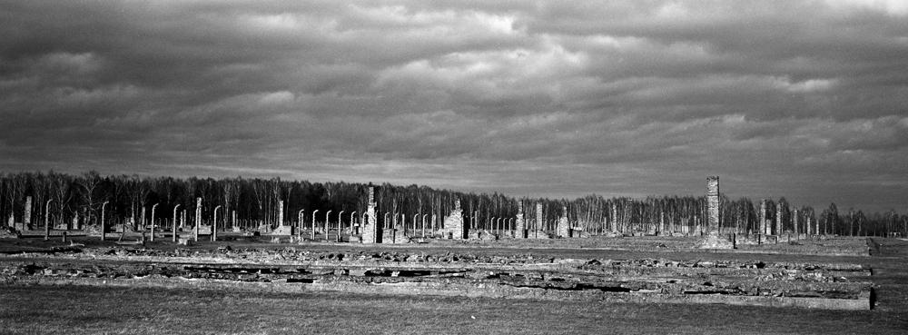 The remains of brick stone chimneys of prisoners barracks inside the former Nazi death camp of Auschwitz Birkenau or Auschwitz II, in Oswiecim