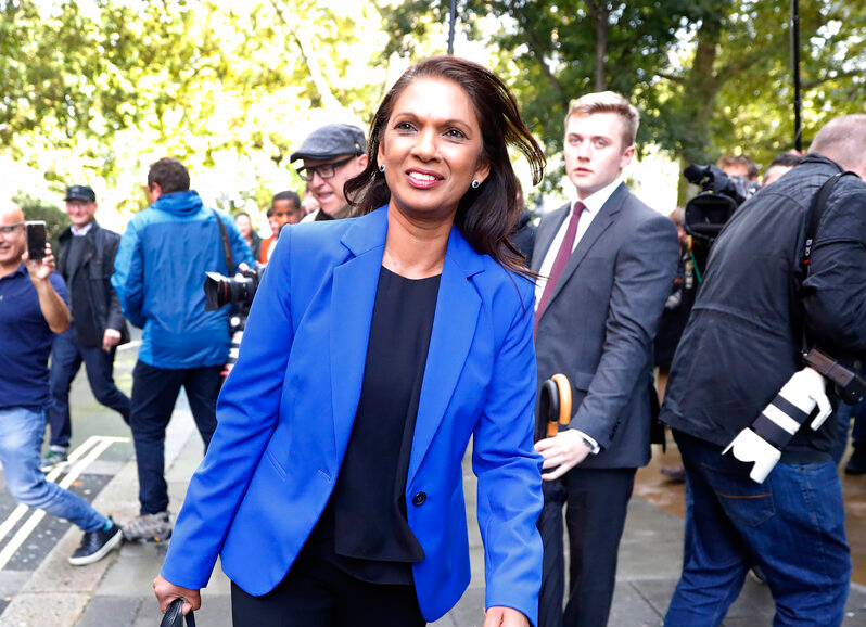 Gina Miller smiles as she walks in London on Tuesday, September 24, 2019.