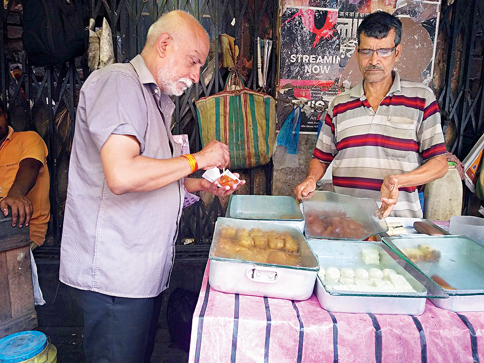 Bablu Kanta Ghosh has been selling Bengali sweets on the pavement near the India Coffee House for nearly 50 years now
