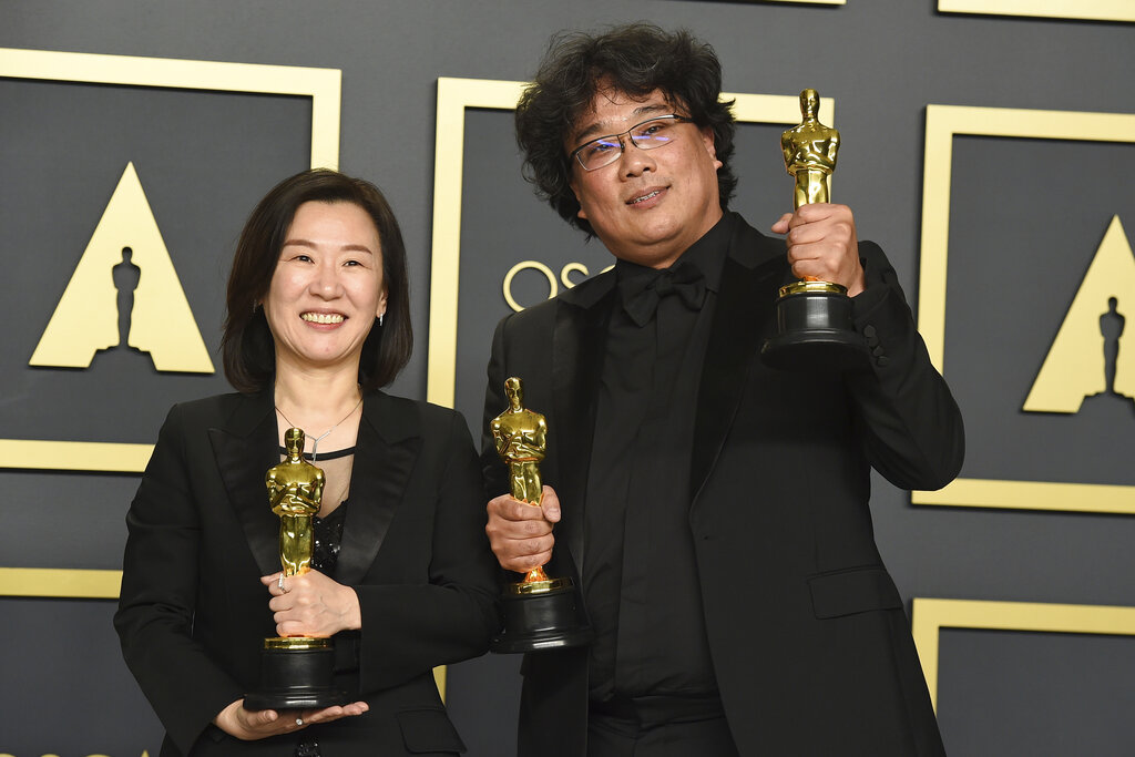 Kwak Sin Ae, left, and Bong Joon Ho, winners of the award for best picture for