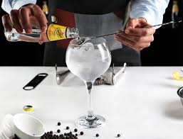 A traditional gin and tonic should have one part gin to three parts tonic and a glass full of ice