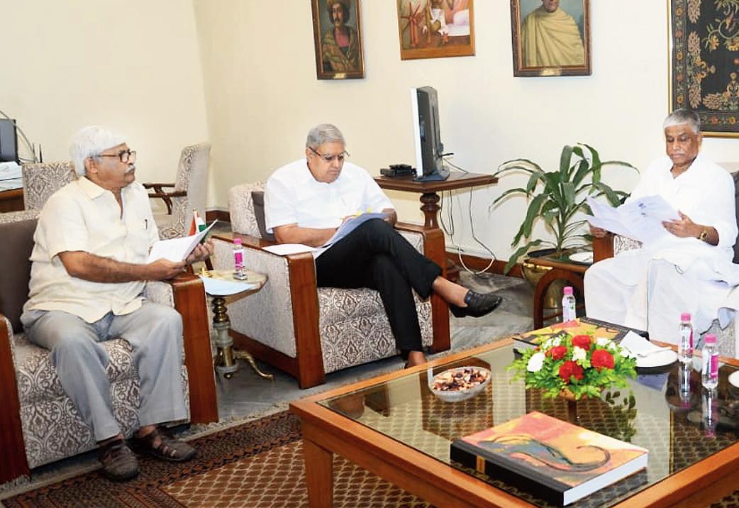 Governor Jagdeep Dhankhar flanked by Sujan Chakraborty (left) and Abdul Mannan at Raj Bhavan on Tuesday.