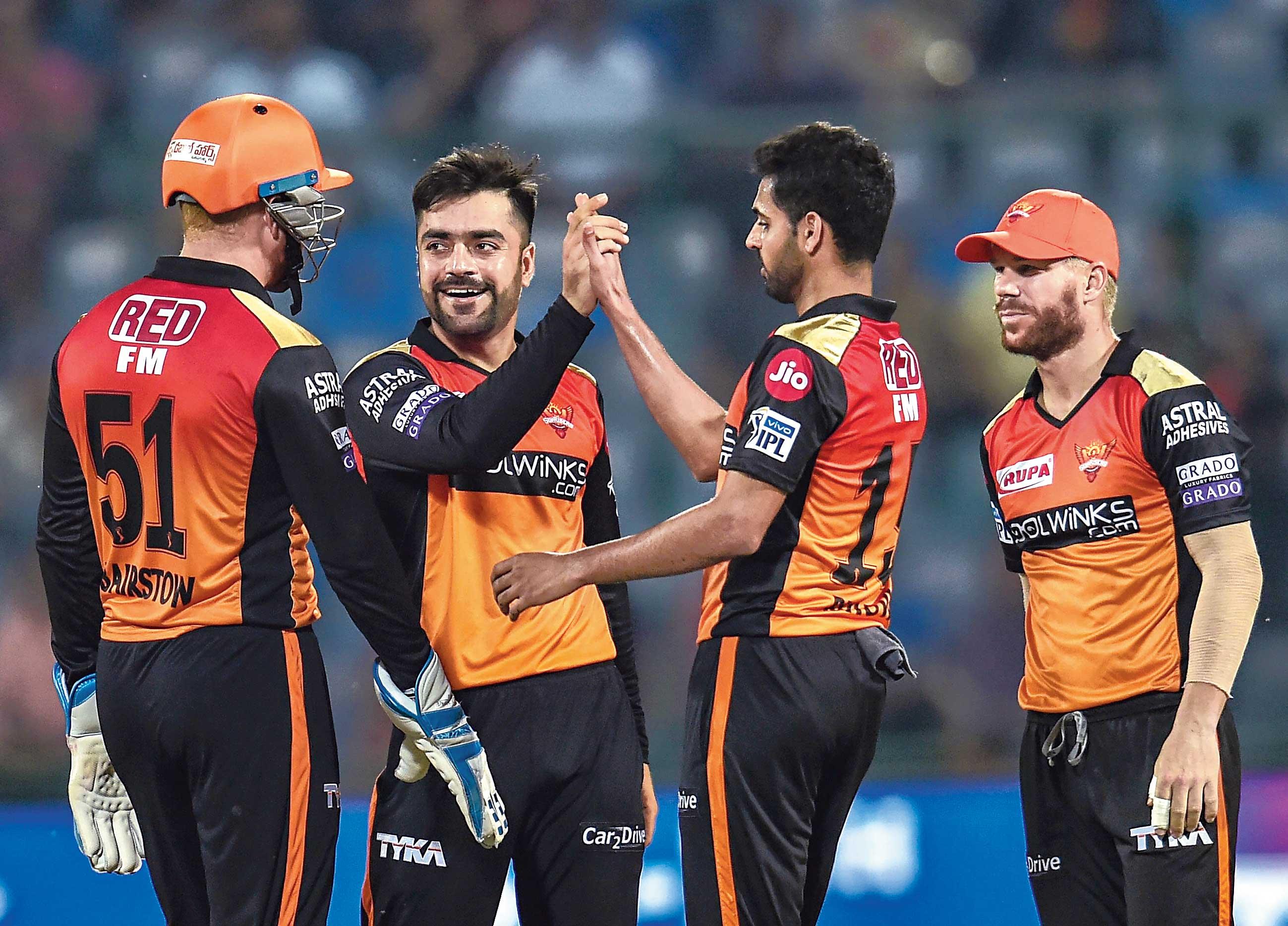 Bhuvneshwar Kumar of Sunrisers Hyderabad celebrates with Rashid Khan, Johnny Bairstow and David Warner the fall of a Delhi Capitals wicket at the Kotla on Thursday.