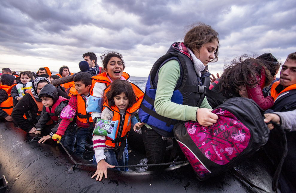 File photo (2015) of Syrian refugees arriving via Turkey, near the Greek island of Lesbos. Many of the refugees on the island are lively and strong people, but they transform themselves into sad and vulnerable beings on the days of their interviews