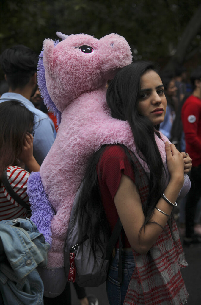 A participant looks on as members of the LGBTQ community and their supporters march during the annual Delhi Queer Pride parade in New Delhi on Sunday, November 24, 2019.