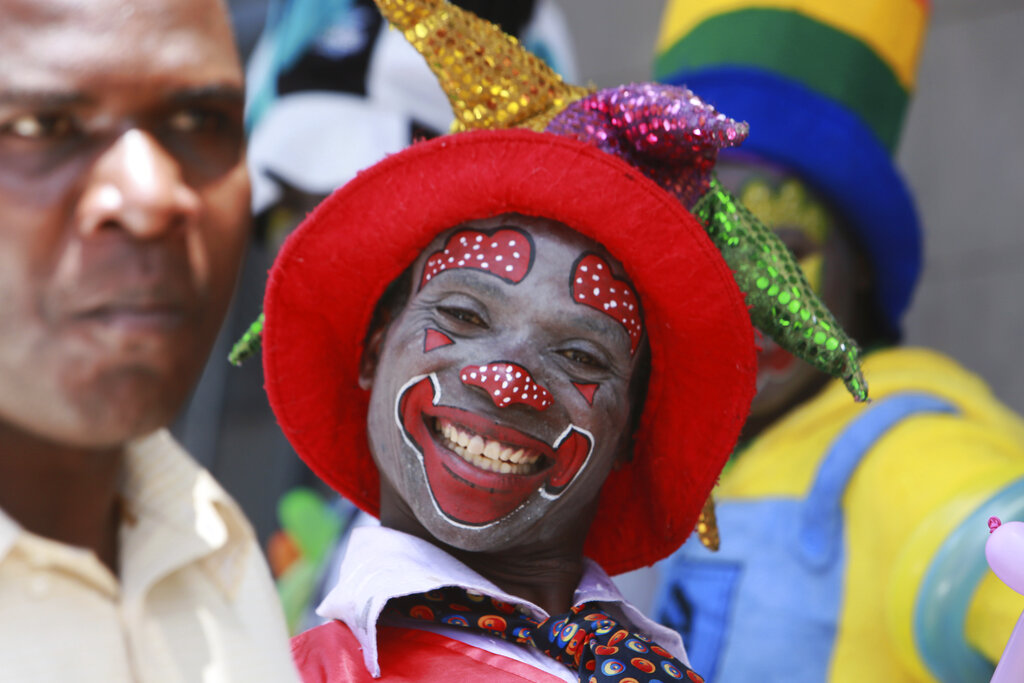 A clown is seen on the streets of Harare in this Saturday, Dec. 21, 2019, photo. Zimbabwe faces Christmas amid a harsh economic crisis that has forced many people to queue for cash and for fuel, making it difficult to plan for the festive period.