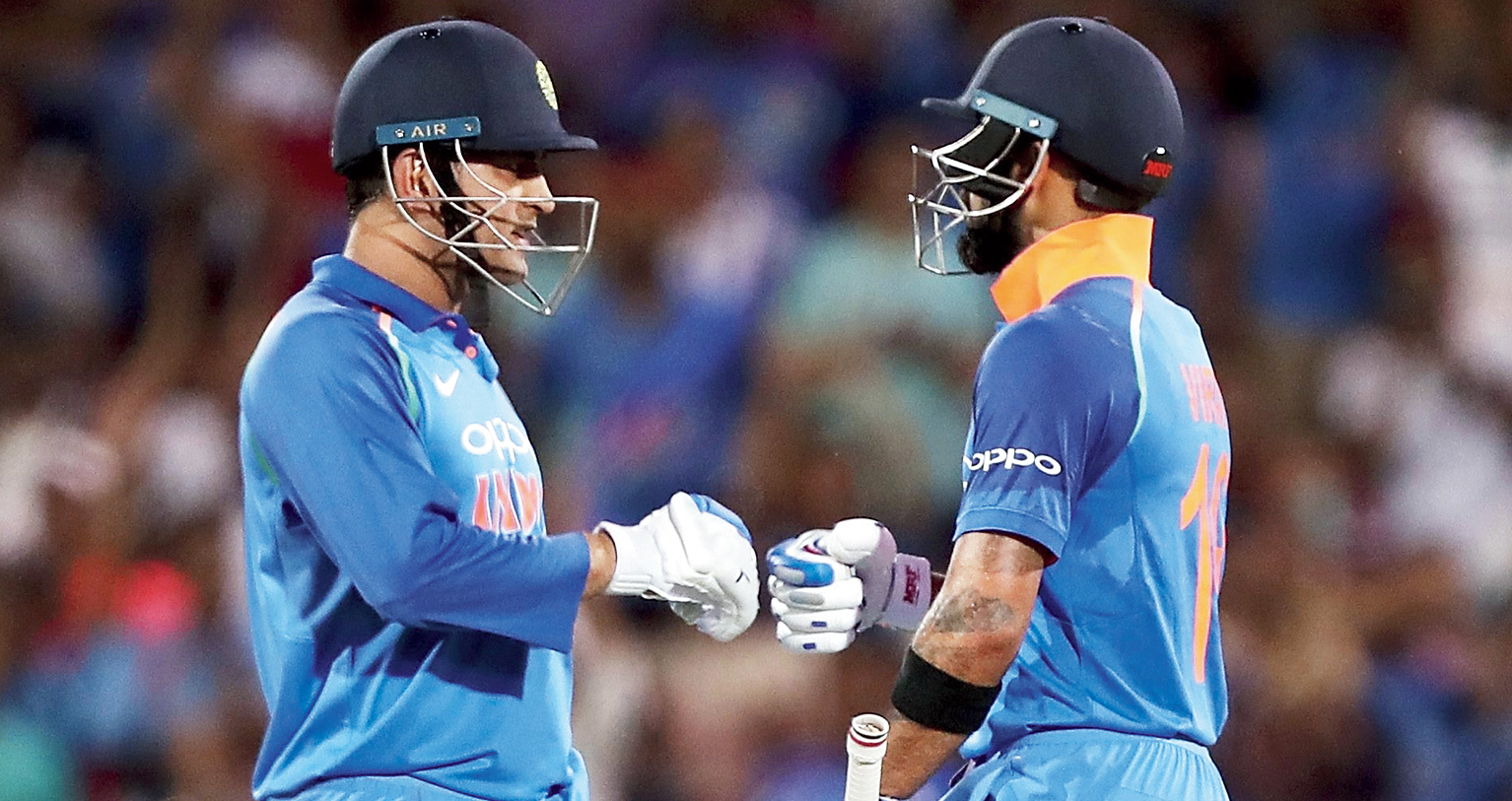 Mahendra Singh Dhoni and Virat Kohli during their 82-run partnership in Adelaide on Tuesday.