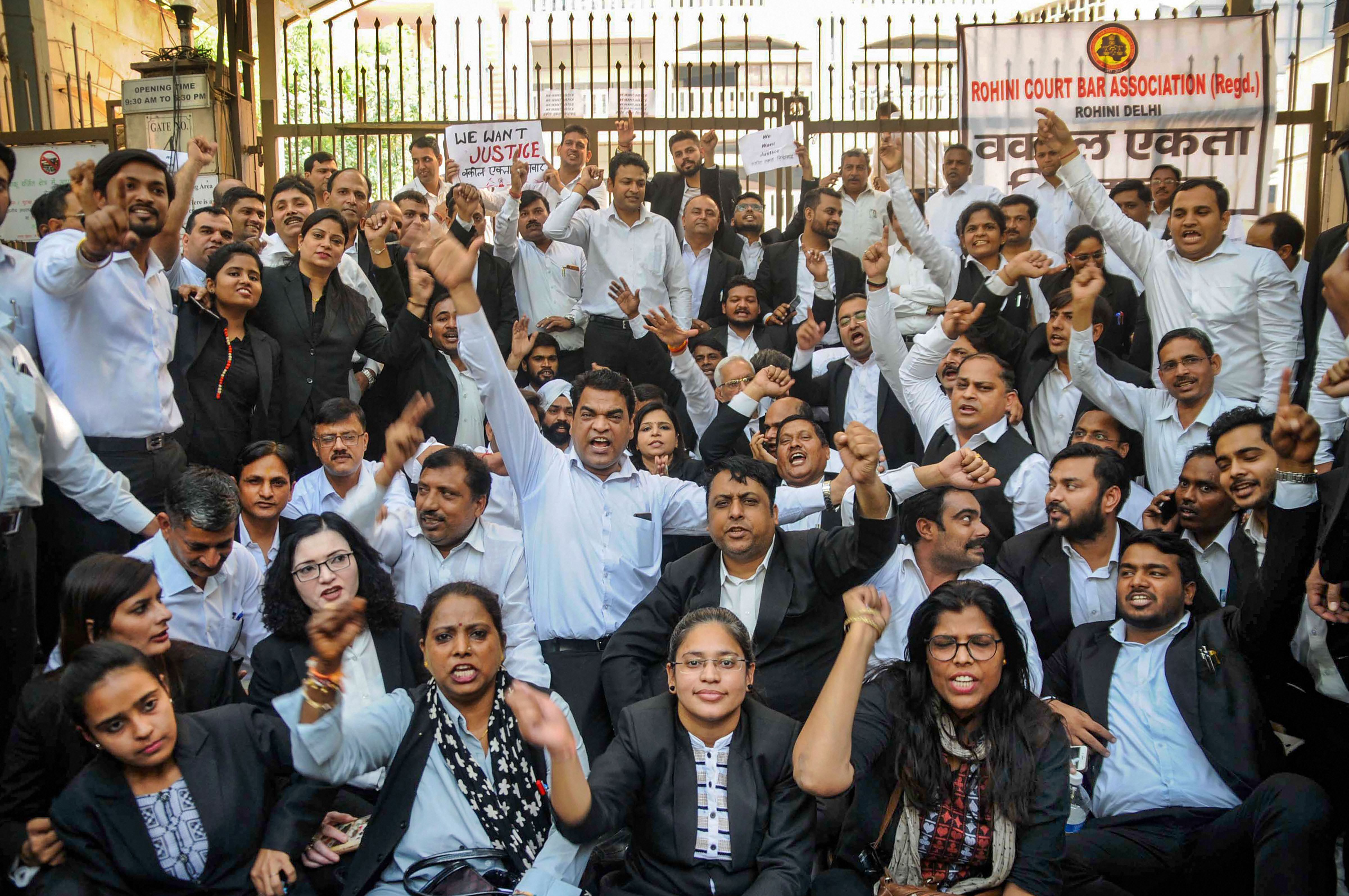 Advocates on November 6 protest outside Rohini court against the clash between lawyers and the police in the  Tis Hazari Court complex in New Delhi.