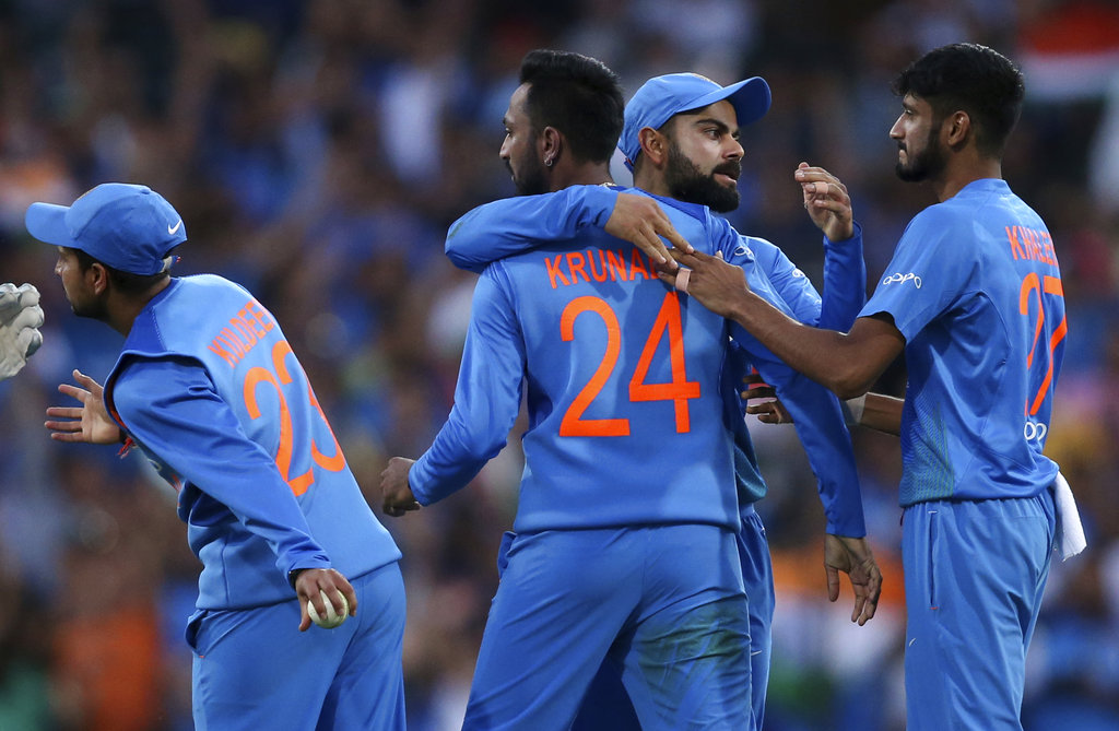 Krunal Pandya is congratulated by Virat Kohli after taking the wicket of Australia's Ben McDermott during their Twenty20 cricket match in Sydney on Sunday.