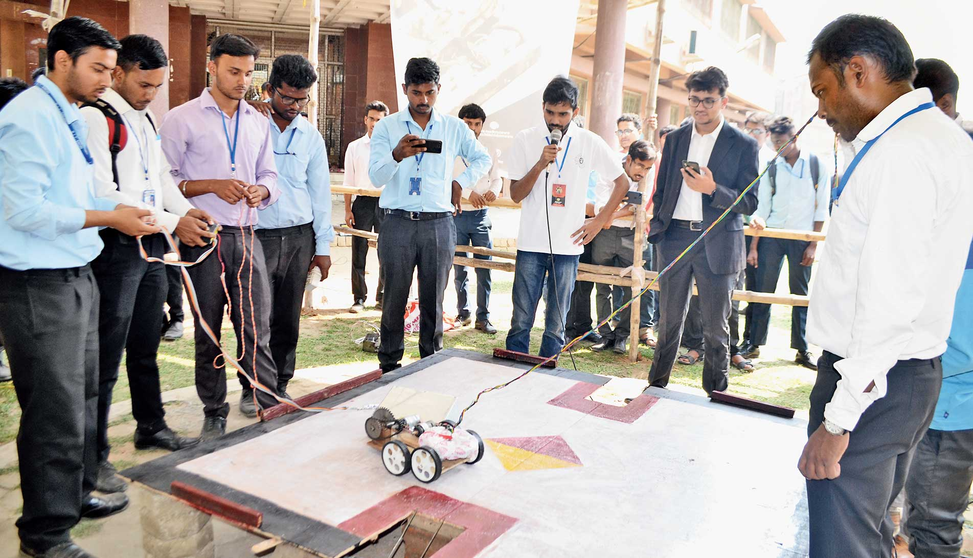 Students display a robot on the first day of the three-day technical fest of BIT-Sindri in Dhanbad on Sunday.