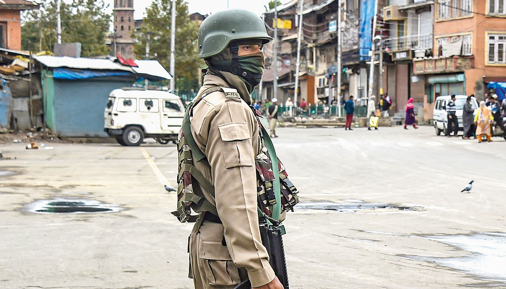 A jawan stands guard during restrictions in Srinagar on October 18.