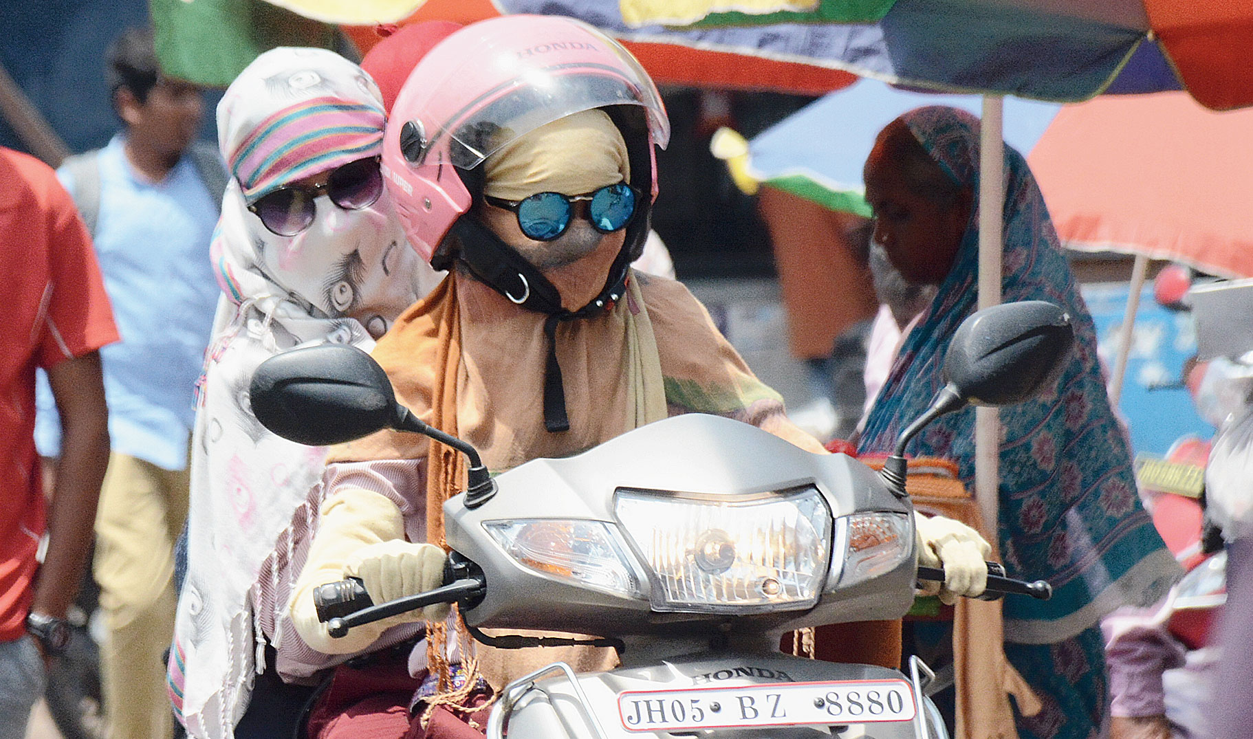 Girls take heat cover in Sakchi, Jamshedpur, on a hot Thursday afternoon.