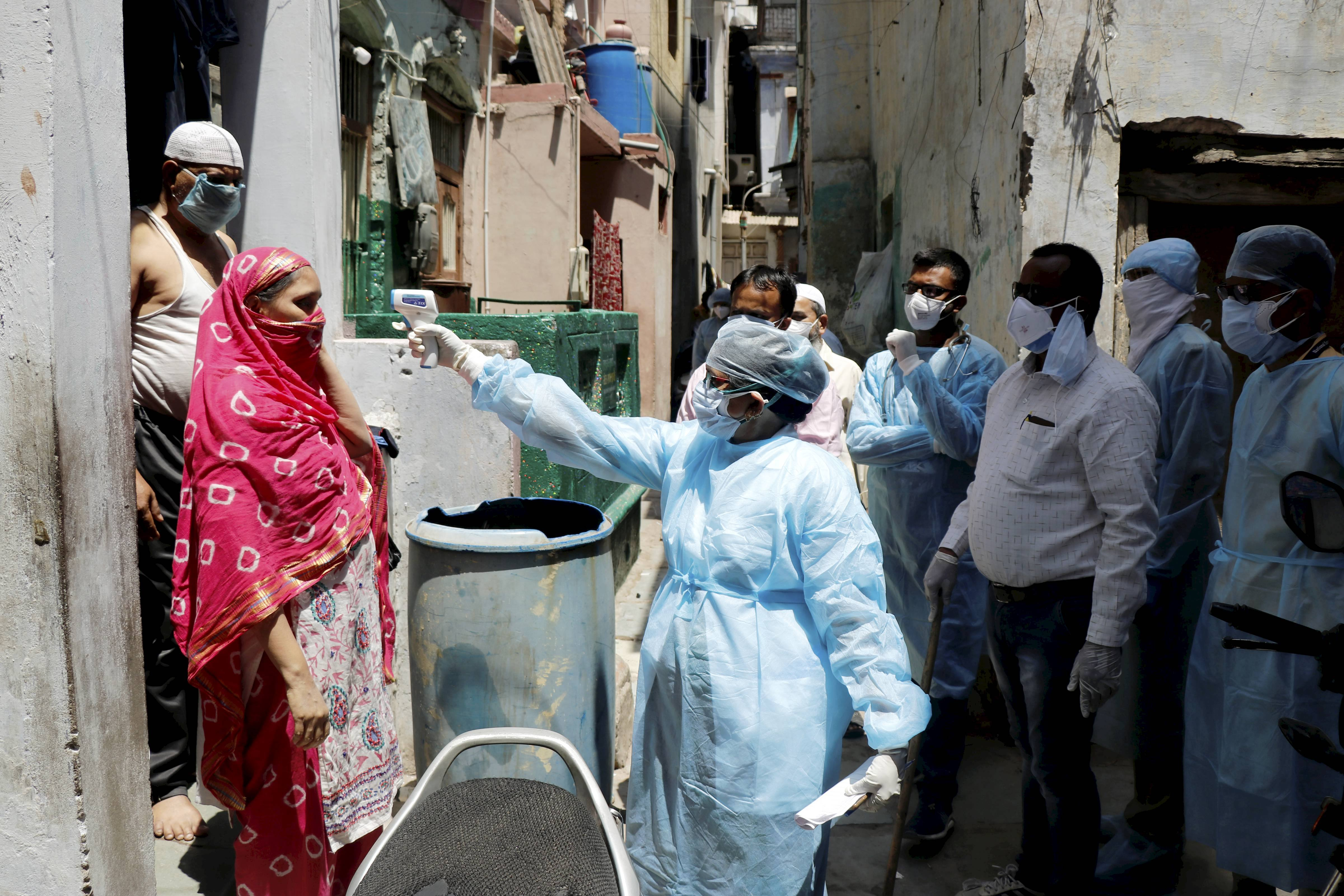 A medical team conducts door-to-door survey to screen people for Covid-19 symptoms, during the nationwide lockdown imposed in wake of the coronavirus outbreak, in Ahmedabad, Thursday, April 23, 2020.