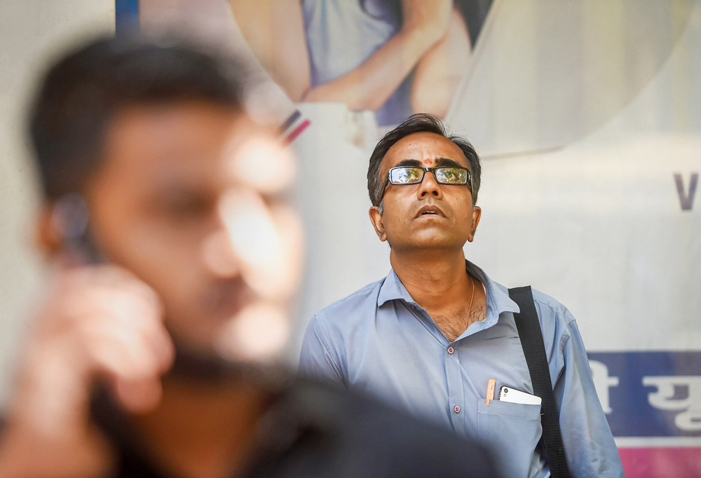 A man watches the screen outside BSE building as Sensex nosedives, in Mumbai, Monday, March 9, 2020. Equity benchmark Sensex plummeted in opening session on Monday led by deepening rout in global markets amid volatility due to rapidly-spreading coronavirus and free falling oil prices.