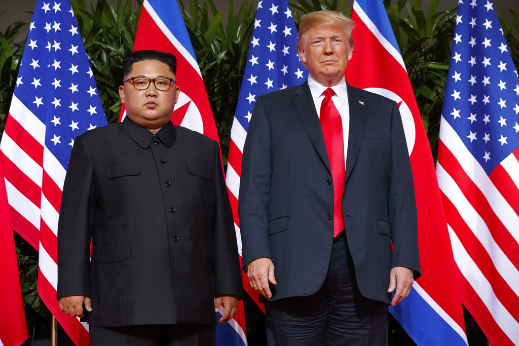 This June 12, 2018, file photo, shows Donald Trump with Kim Jong-un on Sentosa Island in Singapore.