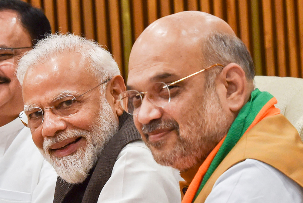 """Narendra Modi and Amit Shah during a BJP Parliamentary Board meeting, in New Delhi on Monday, June 17, 2019. In a congratulatory tweet, Mr Shah described India's triumph against Pakistan in the ongoing cricket World Cup as """"Another strike"""" that has fetched 'similar results'"""