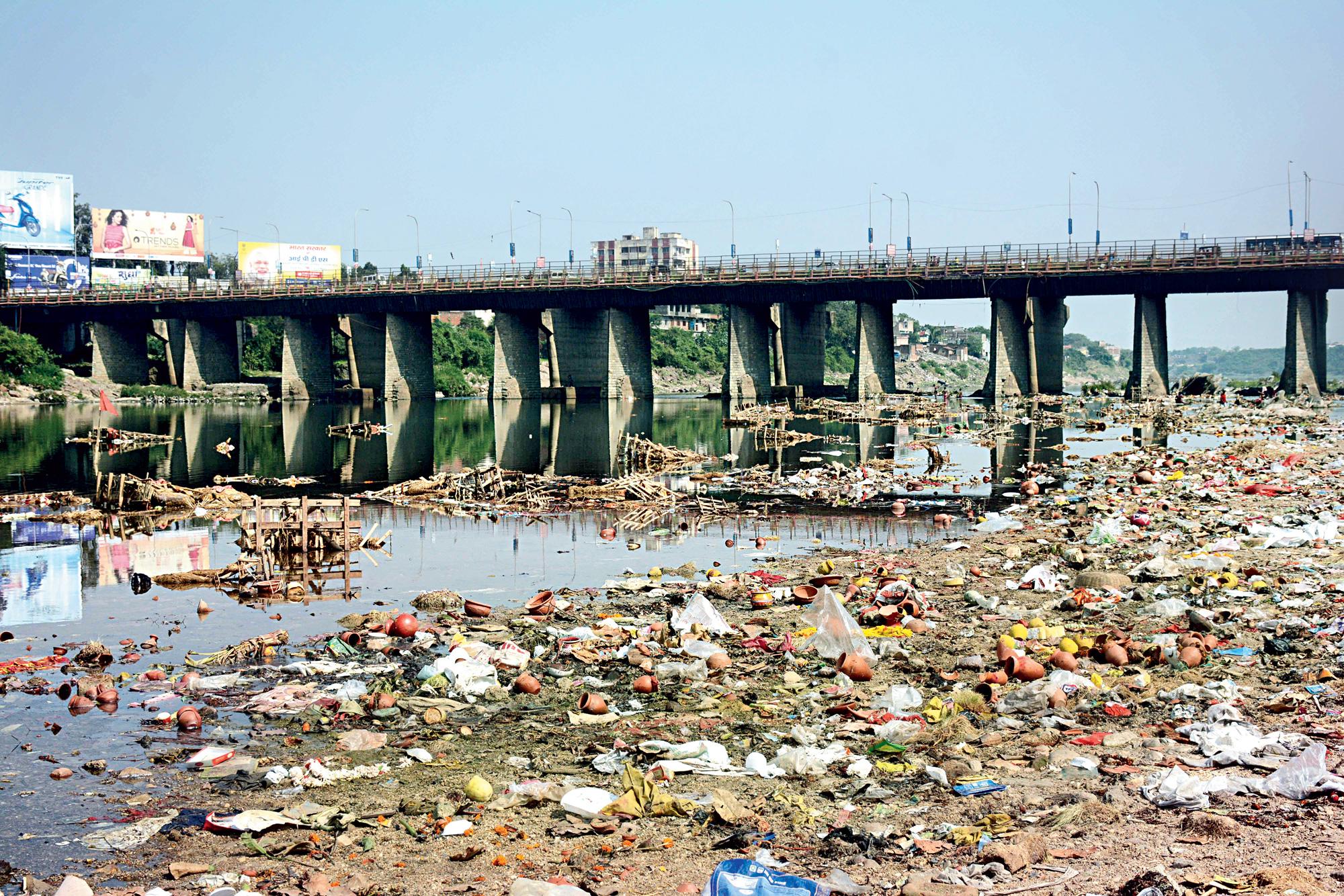 The littered banks of Subernarekha river in Mango, Jamshedpur.