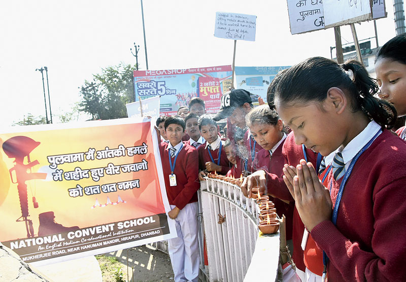 At Randhir Verma Chowk in Dhanbad on Friday, students of National Convent School, Hirapur, pay tribute to the CRPF jawans killed in Pulwama last year.