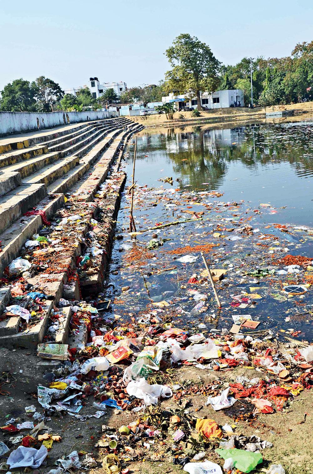 Hatania Talab near Raj Bhavan chokes on puja paraphernalia, including rotting garlands and plastic bags.