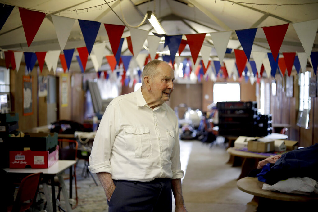 In this May 23, 2019, photo British D-Day veteran David Woodrow, 95, stands in the old mess hall, which during World War II served as part of Hardwick Airfield, on his family's farm near the village of Topcroft, in Suffolk, eastern England